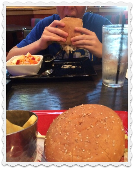 July - Noah with burger